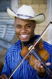 "Talented fiddler, vocalist, accordionist and songwriter Cedric Watson is set to perform Friday, March 14, 2014 at 9:00pm at Mayne Stage in chicago. ""To propel our Louisiana culture into the […]"
