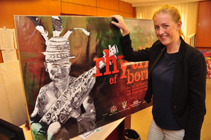 Gina Moor, Sarawak Tourism Board internship student showing the previous design artwork of Rainforest World Music Festival, which has been used for the past 3 years.