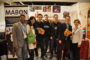 Angelina Bateman (right) and Tony Nagamaiah (left) together with Mabon band members at the announcement during WOMEX in Cardiff, Wales