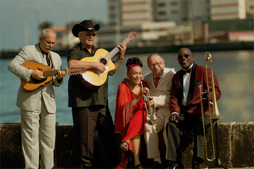 "Orquesta Buena Vista Social Club headliners, left to right: laud player Barbarito Torres, vocalist and guitarist Eliades Ochoa, vocalist Omara Portuondo, trumpeter Guajiro Mirabal, and vocalist and trombonist Jesus ""Aguaje"" Ramos - Photo by Alejandro Pérez"