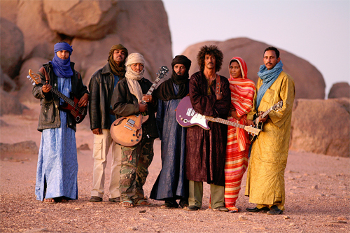 Tinariwen, left to right: Eyadou, Abdallah, Said, Hassan, Ibrahim, Bassa, Intidao - Photo by Thomas Dorn