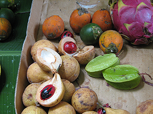 Nutmeg fruit (lower left) at fruit stand in Penang - Photo by Angel Romero