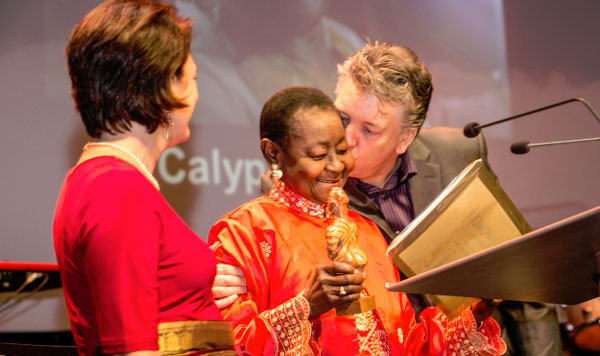 Calypso Rose is presented with the WOMEX 2016 Artist Award by her laudator (WOMEX 2007 Award winner) Ivan Duran. - Photograph by Eric van Nieuwland.