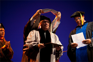 Eddie Gomez (left) receives Berklee honorary doctorate from Larry Simpson (right), senior vice president for academic affairs. Photo by Histeria Producciones