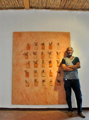 Kofi Setordji and Painting - Photo by Evangeline Kim