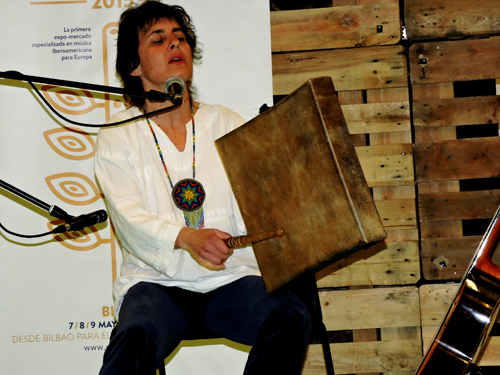 Rosalia Mowgli playing the rare square frame drum from Salamanca