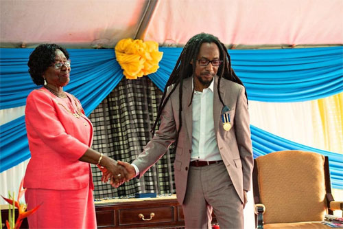 Taj Weekes receiving the Les Pitons Medal (Gold) from the Governor General of St. Lucia, H.E. Dame Pearlette Louisy