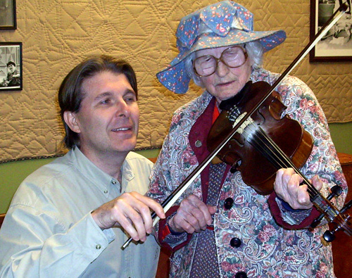 Co-authors Randall Franks and Violet Hensley saw a fiddle tune together at Silver Dollar City in Branson, Missouri