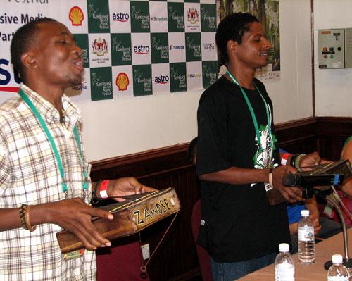 Zawose Family playing ilimbas at press conference - Photo by Angel Romero